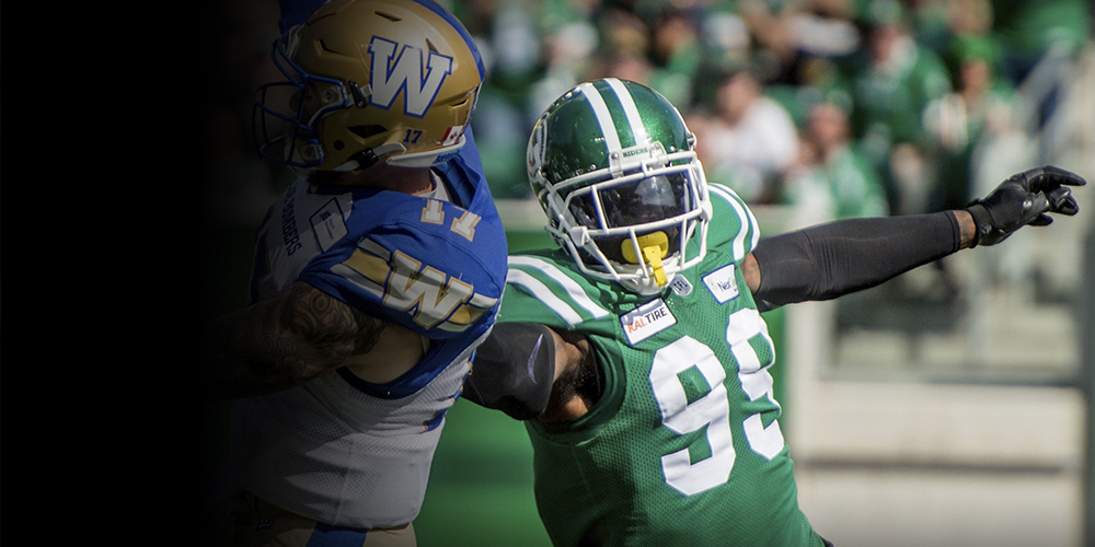 Saskatchewan Roughriders player # 2 ( WR) Jock Sanders tries to run with the ball past Eskimos #47 (LB) JC Sherritt during the 4th quarter of CFL game action between the Edmonton Eskimo's and the Saskatchewan Roughriders at Commonwealth stadium in Edmonton Saturday, June 29/2013 (CFL PHOTO - Walter Tychnowicz)